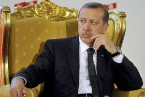 Turkish Prime Minister Recep Tayyip Erdogan attends a signing ce